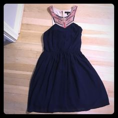 Embroidered Neck Navy Dress Absolutely stunning navy blue polyester dress with a pink/gold/blue embroidered neckline. Back features a cut out but you can still wear a strapless bra with it. Side zipper and hook closure. Worn to two weddings and I received so many compliments on it!  Jealous Tomato Dresses Mini