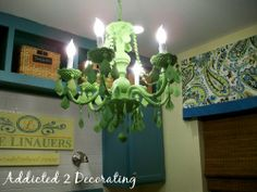 We inherited a tacky chandelier, I am going to attempt to paint it and hang it in our master bath!