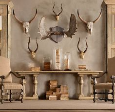 RH's Steer Horns in Cast Resin:Molded from steer horns, our horned skull is crafted from resin, hand-colored and finished for remarkable realism. Dramatic in scale and evocative in form, it has a rugged, rustic, sculptural appeal.