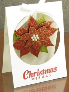 """""""With the help of the Big Shot and the Circle Framelits, I was able to create a window card that showcased a beautiful poinsettia ornament inside. It reminds me of a ornament hanging on a tree or in a window. Christmas Poinsettia, Stampin Up Christmas, Christmas Greetings, Handmade Christmas, Holiday Cards, Christmas Cards, Christmas Holiday, Xmas, Window Cards"""