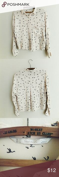Zara Trafaluc Bird Print Blouse Cropped, button down peach-colored blouse with a black and white bird print (maybe cranes?) In excellent condition! Size Small, 100% Viscose. Zara Tops Button Down Shirts