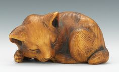 Carved cat netsuke.