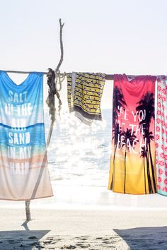 Relax on the shoreline with soft beach towels in pretty prints and  bright hues!   H&M Home