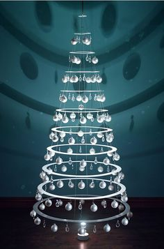 The High Modernist's Christmas Tree. This Christmas tree is composed of 11 concentric acrylic rings that form a three-dimensional conical shape when suspended from the ceiling. Only available from Hammacher Schlemmer, it is suggestive of high modernism's use of technology to ameliorate the natural world, employing nearly 200 eye-catching ornaments that blend traditional elements with the avant-garde. #ChristmasTree #ChristmasDecor