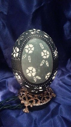 Carved Emu Egg Flowers by loxie28 on Etsy