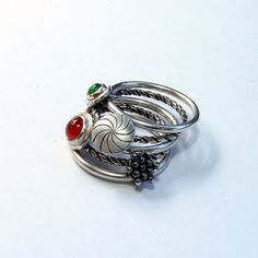 silver stacking rings attached with four movable parts by SILVENE