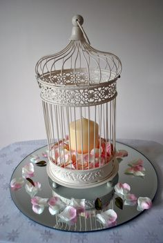 cute centerpieces can do the birdcage with rustic base instead of mirror
