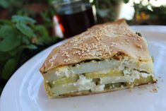 """""""Kolokithoboureko"""" or Boureki from Chania. The word boureki comes from the Turkish börek which can be translated internationally as """"filled pastry"""". Small variations of this… Unique Recipes, Greek Recipes, Crete, Sandwiches, Canning, Food, Ideas, Chef Recipes, Cooking"""