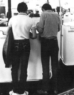 Freddie Mercury (L) and John Deacon (R) at the airport.