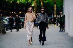 Two women wearing sweaters
