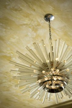 - A glowing light fixture beneath a painterly ceiling.....contemporary eclectic