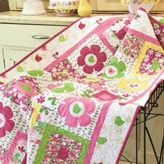 All A-Twitter wall quilt pattern featuring cute birds and cheery appliquéd flowers is fast and fun to make. Our FREE online video shows you how to secure the appliqués with machine quilting. Featured in McCall's Quick Quilts June/July 2012.
