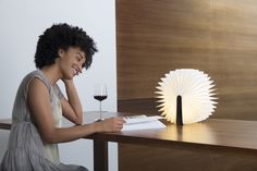 The Lumio book lamp looks like a hard-cover book when folded, but opens up all the way to make a standing lamp as shown here. It can also lay like a half-open book, or hang on a wall, or even  go around a corner - just open it to 270 degrees! And it's portable. Lumio opens to 360 degrees and comes with a custom orange micro-USB charger, magnetic wooden pegs for mounting, and a beautiful leather strap for hanging. Comes in two sizes. This is the large version, for $190USD. The smaller…
