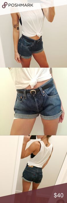 Levi's 501 Cut-offs Excellent condition, no flaws. Levi's 501 high-waisted button fly cut-offs. I think these are a size 30-32 waist (they no longer have the size tag and I can't remember exactly) I'm a size 2, but I wear them cuffed and belted as a boyfriend style shorts (pictured). Dark wash. Levi's Shorts Jean Shorts