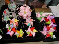 Kanzashi shop in Gion. The pinwheels (風車) and plum blossoms (梅) are for February. On the left are some July uchiwa kanzashi