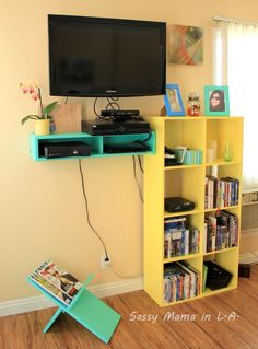 simplify the living room with a floating electronics shelf and simple magazine rack #buildit  #organize