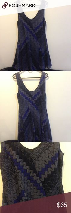FREE PEOPLE Purple Psychedelic Skater Dress Free People dress in purple with grey tones and has a psychedelic print. Sleeveless and lined- no closures and size tag is removed. I am pretty sure this is a size 10 but may be a 12. I can measure if needed. In new condition- worn a few times and has no apparent wear :) Free People Dresses Midi