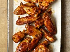 Tomato-Glazed Chicken Wings | Food & Wine goes way beyond mere eating and drinking. We're on a mission to find the most exciting places, new experiences, emerging trends and sensations.