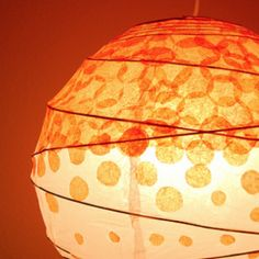Cut some dots from tissue paper and apply them to an inexpensive lantern for a fab décor look on a budget!