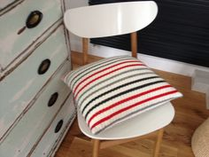 Machine knitted cushion with wool outher material and feather filling. From Nordic Nic Nac