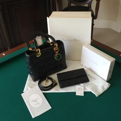 Christian Dior Authentic Lady Dior Handbag Vintage CD Lady Dior handbag in size medium, black lamb skin.  Includes tags, boxes and dust bags.  Rarely used.  Also includes matching wallet.  Never used shoulder strap included .  Wallet has 3 pouches and zipper pouch in back.  New purse $4100.  New similar wallet with less pouches $980. Dior Bags
