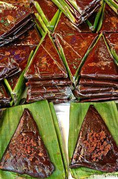 Kalamay (Sweet Stcky Rice Cake with Sweet Coconut Glaze). alternate here: http://blog.junbelen.com/2012/06/20/how-to-make-kalamay-na-pinipig-pinipig-rice-cake/ or here: http://www.pinoycookingrecipes.com/kalamay-ube.html or here: http://www.filipino-food-recipes.com/kalamay.html