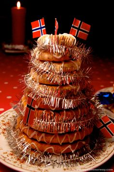 Kransekake is a cake made from almonds, icing sugar and egg whites. The dough is a little coarser than marzipan and sometimes has specs of almond skin as a 'rustic' feature.read more...
