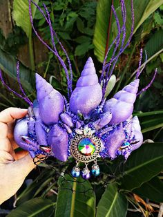 Check out this item in my Etsy shop https://www.etsy.com/listing/538234486/purple-sea-siren-seashell-mermaid-crown