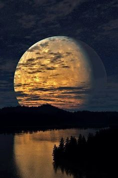 Huge Regal Magic Moon rising above dusky river and forests x This is sooo beautiful! I love the reflection of the sky landscape in the image of the moon.