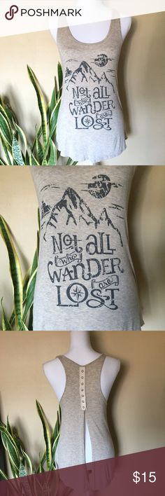 "Woman's Graphic Tank Top Woman's Graphic Tank Top, Gray, Size M  Heather gray graphic tank ""Not all who wander are lost"". 7 snaps closures open bottom back. Tops Tank Tops"