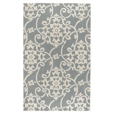 Anchor your living room seating group or define space in the den with this artfully hand-tufted rug, featuring a linked medallion motif for eye-catching appe...