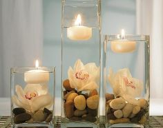 Use rocks or even extra of those small tiles :) - Outdoor Wedding Table Decorations   eHow.com
