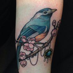 Elegant tattoo by Eilo Martin.
