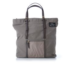 Made of cast off recycled fishing nets the Ecoalf tote is trimmed in leather, super lightweight and ideal for travel or daily life.  www.roztayger.com    • Sports leather feet  • 6.5 inch leather handle drop  • One ex...
