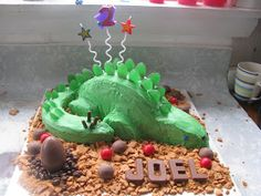 I volunteered to make my friend's boy's birthday cake- any excuse as far as I'm concerned. It wasn't perfect but lots of fun to make an. 2 Birthday Cake, Dinosaur Birthday Cakes, Dinosaur Cake, 4th Birthday, Dino Cake, Cake Decorating, Decorated Cakes, Gabriel, Cake Ideas