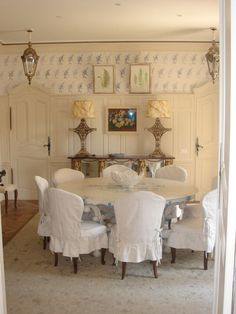 Nicky Haslam Design -- built-in doors to the ornate wainscot!