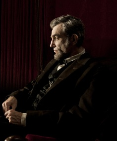 Still of Daniel Day-Lewis in Lincoln    Daniel Day Lewis became the first person to win three Academy Awards. This is him as he portrays Abraham Lincoln....in Lincoln.