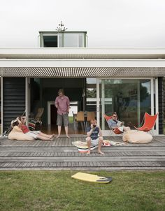 The Parsonson Residence, a modern beach house in New Zealand, features slide-away doors and a large patio perfect for sunbathing and looking out toward Kapiti Island.   Love these stepped patios
