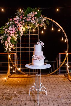 Round mesh wedding arches wrapped in twinkling lights and oversized floral accents make a perfect backdrop for simple cake tables. A simple and elegant cake table with a gorgeous backdrop stand will wow the guests at a baby shower, quinceanera, wedding or wedding day. #caketablewedding #caketabledecorations #caketableideas #caketablebackdrop #archbackdrop Cake Table Backdrop, Cake Table Decorations, Backdrop Decorations, Ceremony Decorations, Outdoor Wedding Backdrops, Wedding Reception Backdrop, Wedding Arches, Backdrop Frame, Backdrop Stand