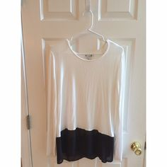 Forever 21 long sleeve Super cute and comfy and never worn before top. White with sheer black trim on the bottom. Adorable with a pair of leggings and boots. Forever 21 Tops
