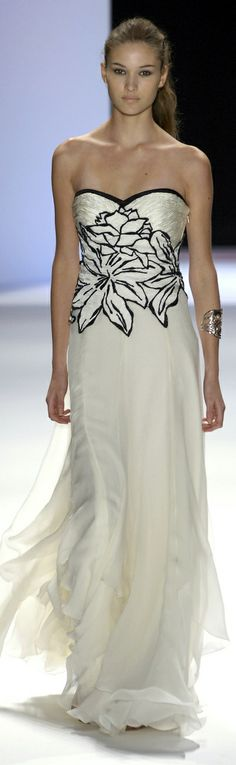 This white gown with black floral detailing and black hemming on the neckline is very pretty, yet a bit more stand-offish than stand-out of the crowd. Super cute.