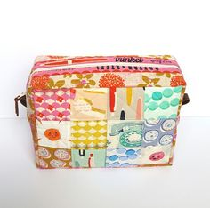 Cute little zippered patchwork case. No tutorial, but you can probably reverse-engineer it.
