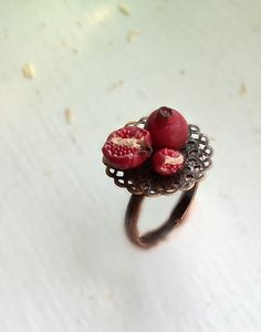 Pomegranate ring - http://etsy.com/shop/bookmarksnrings