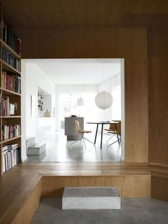 Villa Wienberg, wood and white interior, library, round-shaped lamp, table, chairs