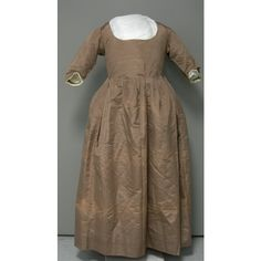 Cannot recall where this is from, but it is a gown with a Quaker provenance, very plain, tan silk.