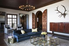 Celebrity Designer Kendall Wilkinson | Decorist Home and Interior Decorating....so couch color and plushness and the wooden doors.  I like the coffee table idea with seating stored under just not a fan of glass....maybe in leather, yep leather