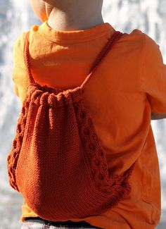 Free Knitting Pattern for Teensy Treasures Bag - This drawstring backpack with honeycomb cables comes in sizes from child to adult. Small (Medium; Large; Extra-Large). Designed by Gretchen Tracy