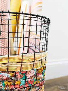 Wrapping paper and fabric rolls stay on display (and close to hand) with our wire basket storage idea. To spice up the store-bought basket, weave long strips of torn fabric through the holes of a wire basket. Tie knots on the back of the basket to secure each strip.