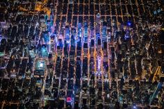 Aerial Pictures of New York at Night  Photographer Vincent Laforet, whose we already have talked about on Fubiz, shows us here an amazing view on the city of New York. From a helicopter, he makes us discover the big apple, at night, through aerial cliches where we can admire the city lights. Find out more in the gallery.