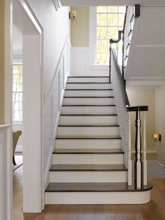 Paneling height the same as the stairway handrail.  Georgian Inspired Farmhouse by Conner Homes